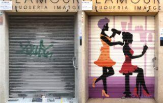 Graffiti en la persiana de una peluqueria de Barcelona